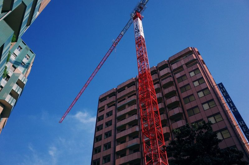 Architecture Blue Building Building Exterior Built Structure City Clear Sky Construction Equipment Construction Industry Construction Site Crane - Construction Machinery Day Development Industry Low Angle View Machinery Nature No People Office Building Exterior Outdoors Sky Skyscraper Tall - High