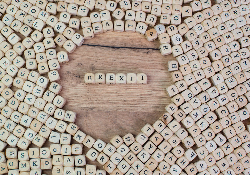 Brexit name in letters on cube dices on table Cube Great Britain Industry Letters Text Union Wooden Table Word Brexit Commerce Concept Diplomacy Diplomat Eu Europe Flat Lay Keyword Label Macro Negotiations Referendum Representative