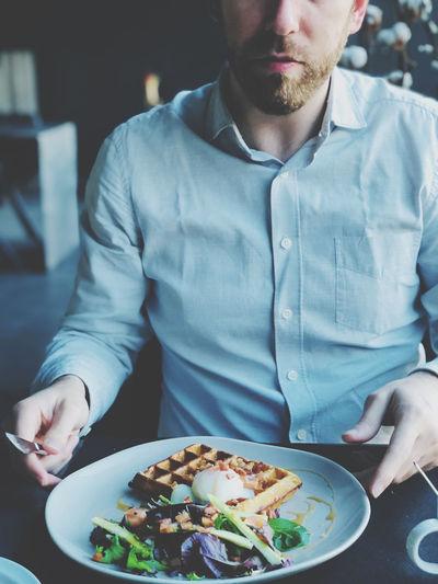 Midsection of man having breakfast