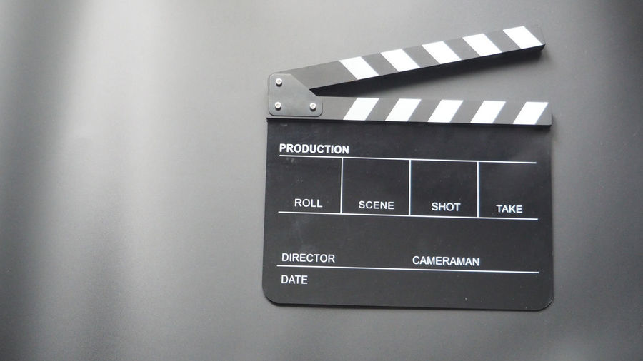 Clapper board or movie slate use in video production or movie and cinema industry. It's black color. Blackandwhite Film; Slate Acting Camera Production TakeoverContrast Black Board Black Color Board Camaraman Cinematography Clapper Clapper Board Clapperboard Close-up Cute Directoe Indoors  Movie Slate; Movie; Clapper; Slate; Film; Board; Production; White; Clapperboard; Isolated; Industry; Director; Scene; Studio; Action; Cut; Video; Black; Object; Shot; Clapboard; Blank; Hand; Media; Making; Set; Finger; Empty; Green; Screen; Red; Blue; Small; Real; No No People Production Line Scenery Video;