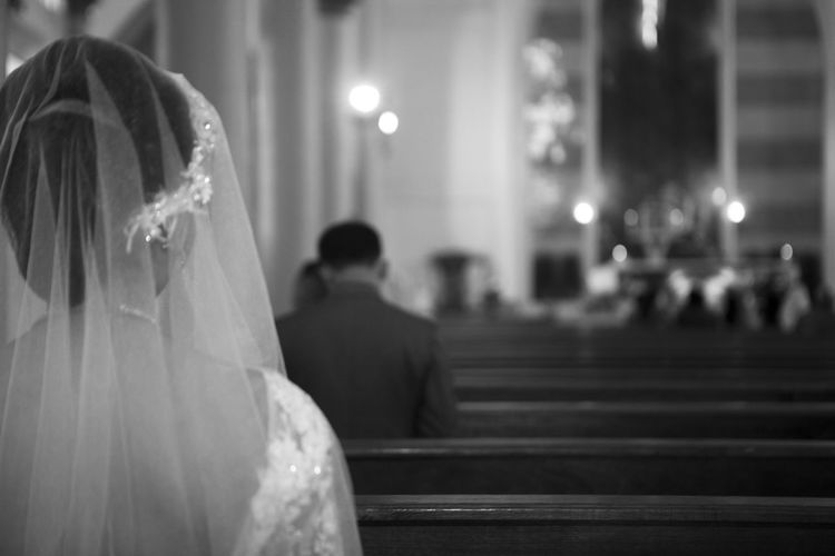 Close-up of bride sitting in church