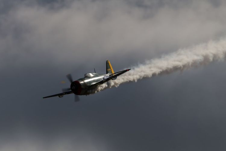 Low angle view of republic p-47 thunderbolt flying in sky