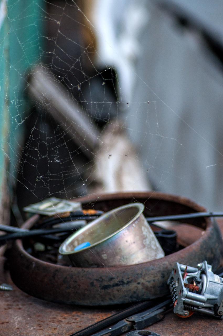 CLOSE-UP OF OLD BROKEN SPIDER WEB