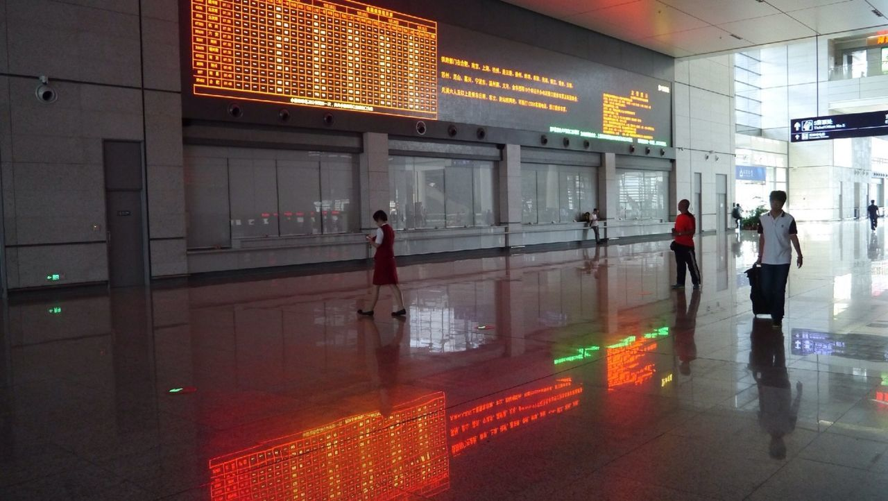 walking, real people, men, illuminated, indoors, reflection, airport, transportation, women, technology, architecture, day, people