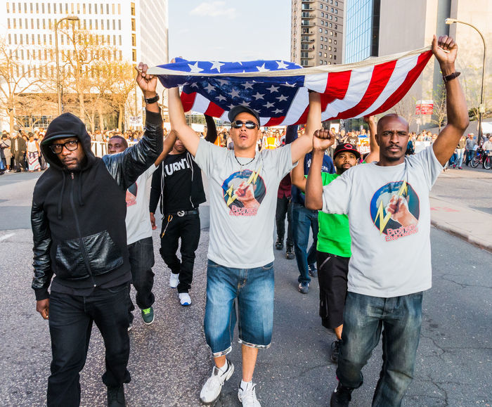 Men carrying US flag during rally/protest. African American Architecture Blacklivesmatter Blackmen Capital Cities  Casual Clothing City City Life Culture Leisure Activity Lifestyles Medium Group Of People Mixed Age Range Outdoors Power To The People Protest Race Rebel Social Documentary Streetphotography Urban