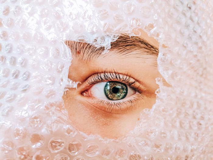 Eye peeking through plastic bag