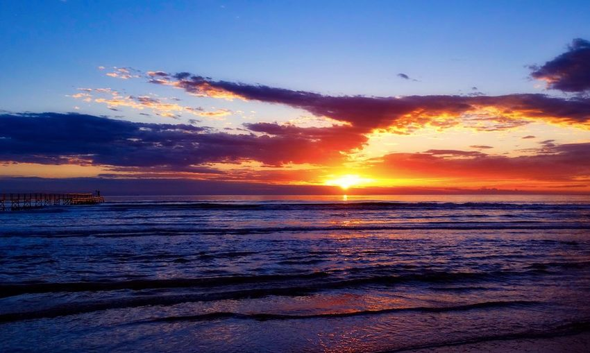 Sunset Sea Beauty In Nature Scenics Nature Tranquil Scene Water Tranquility Sky Orange Color Beach Horizon Over Water Sun Cloud - Sky Silhouette Idyllic Dramatic Sky Outdoors No People Wave Live For The Story Live For The Story