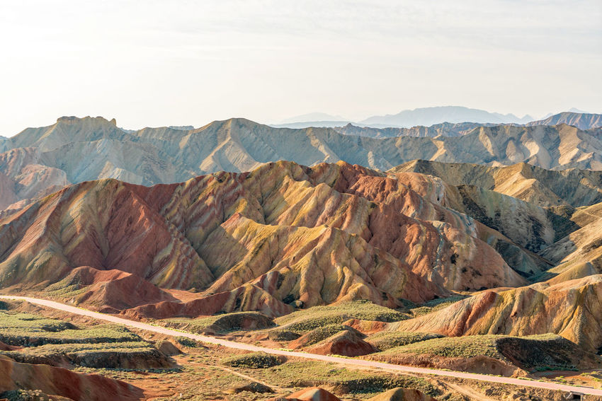 Rainbow Rocks. Zhangye Danxia Landform, Gansu, China Arid Climate China Colour Day Desert Gansu Geological Formation Landscape Mountain Natural Beauty Nature Orange Color Outdoors Path Pattern Physical Geography Red Remote Road Rock Formation Travel Travel Destinations Travelling Zhangyedanxialandform High Resolution
