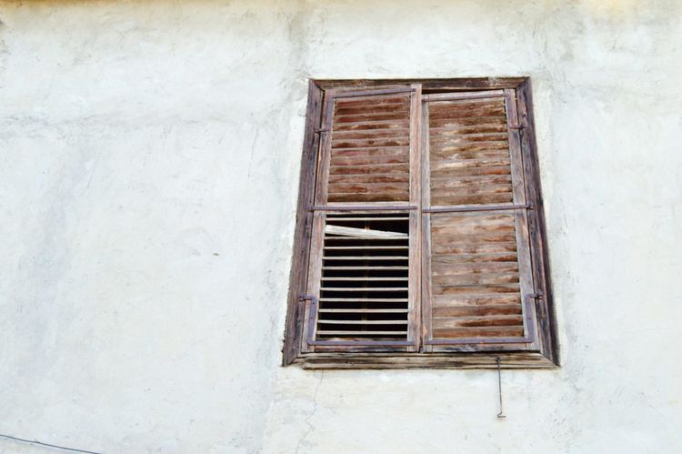Windows Wooden Broken Missing Parts Brown Color Exterior Old Vintage Abandoned Place Architecture Building Design Art Streetphotography Street Security Bar Metal Grate Air Duct Window Architecture Building Exterior Close-up Built Structure Weathered Window Box Shutter Peeling Off