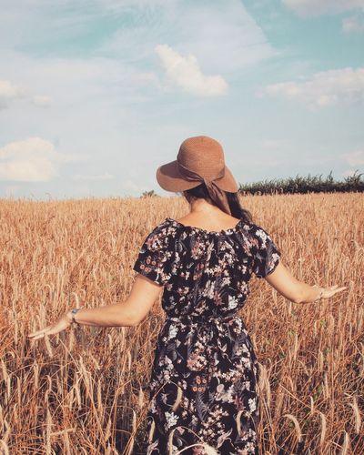 Rear View Of Woman Walking At Farm