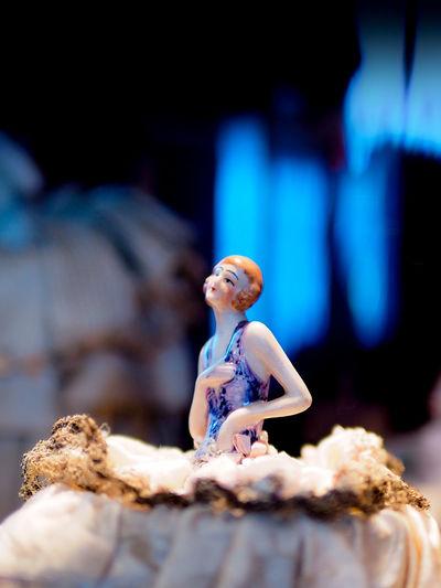 Figurine on wood