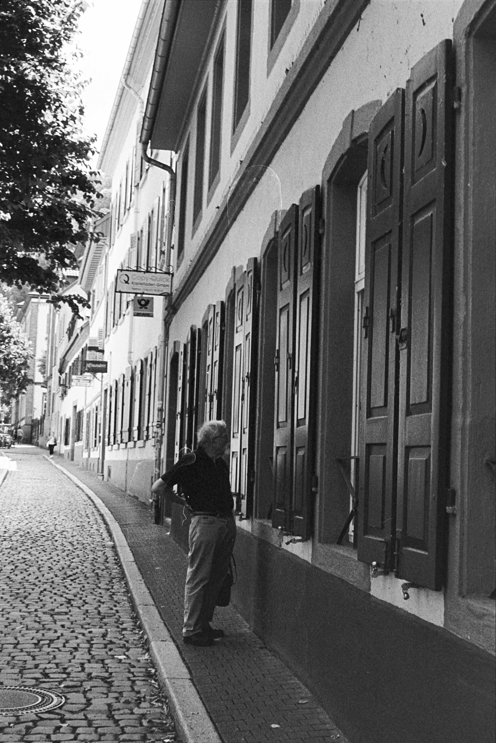 building exterior, architecture, built structure, one person, real people, city, full length, street, lifestyles, building, footpath, leisure activity, day, women, walking, casual clothing, adult, rear view, direction, outdoors, warm clothing