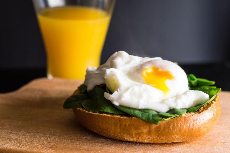 Egg Bagel Bagel Breakfast Breakfast Egg Egg Yolk Food Food And Drink Freshness Healthy Eating No People Orange Juice  Orange Juice  Poached Egg Ready-to-eat Toasted Bread Yoke