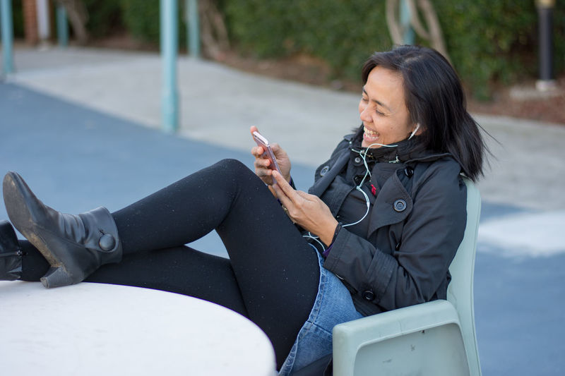 Uni student laughing on the phone Happy Laughing Natural Light Portrait Student Life Students Day Asian Beauty Asian Girl Black Jacket Courtyard  Day Time Female Girl Listen To... Girl On Phone Girl Sitting Girl Smile On The Phone Outdoors People people and places person Sitting Alone University Press For Progress