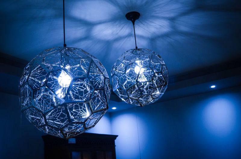 Low Angle View Of Illuminated Pendant Lights At Home