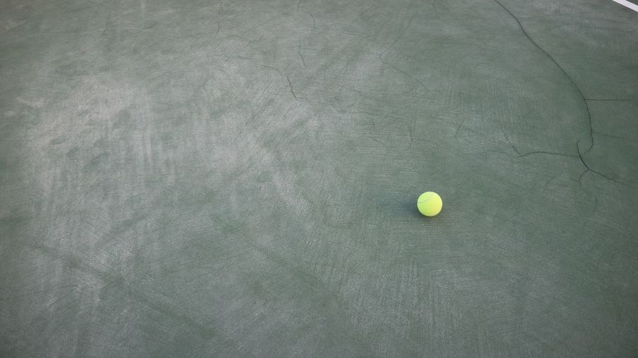 High angle view of tennis ball at court