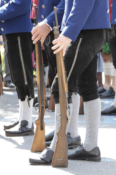 Bavaria Close-up Day Gun Club Human Body Part Human Hand Human Leg Low Section Men Oberammergau Outdoors Parade People Procession Real People Shooting Club Standing Togetherness Tradition Traditional