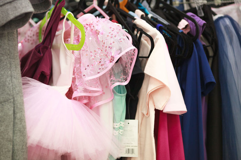 Fashion Clothing Pink Color Coathanger Dress Hanging Rack Retail  Store Choice In A Row Shopping Variation Multi Colored No People Indoors  Clothes Rack Clothing Store Lifestyles Textile Boutique Garment Retail Display Womenswear Purple