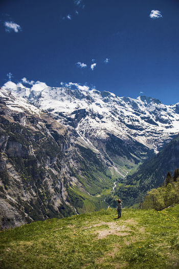Activity Adventure Beauty In Nature Boy Cloud - Sky Day Environment Glacier Grass Hiking Idyllic Landscape Leisure Activity Mountain Mountain Range Nature Non-urban Scene One Person Outdoors Scenics - Nature Sky Snowcapped Mountain Tranquil Scene Tranquility