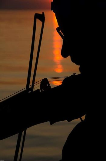 Fiddle the sun down at Grand bend Silhouette Fiddle Nikon D7000 Nikonphotography Nikon Life Grand Bend, Ontario Canada Coast To Coast Sunset_collection Sunset Atthebeach Musician Water_collection