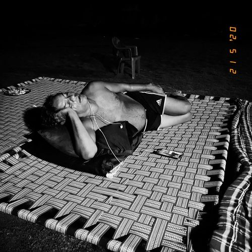 High angle view of woman lying on footpath