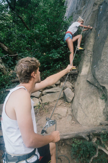 Balkan Roadtrip Activity Adult Adventure Casual Clothing Climbing Extreme Sports Holding Leisure Activity Nature Outdoors People Rock Rock - Object Rock Climbing Rope Safety Safety Harness Sport Young Adult Young Men