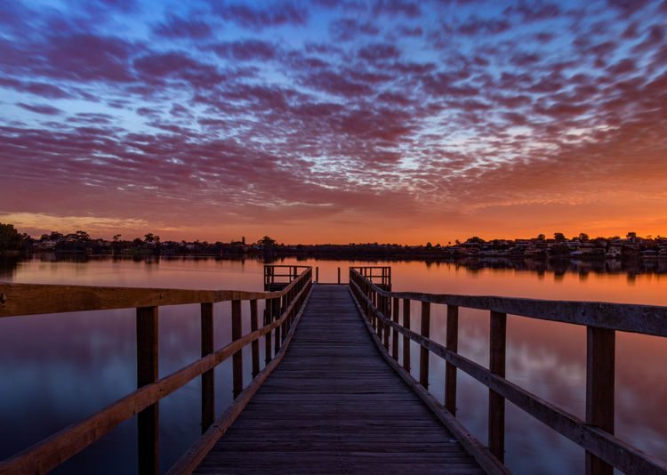 The Long Way Home Perth Australia Beauty In Nature Cloud - Sky Diminishing Perspective Direction Idyllic Lake Nature No People Orange Color Outdoors Pier Railing Reflection Scenics - Nature Sky Sunset The Way Forward Tranquil Scene Tranquility Water Wood - Material Wood Paneling