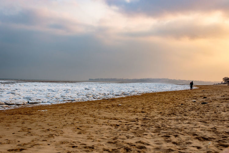 Frozen Hebei Ice Seashore Winter Beach Beauty In Nature Beidaihe China Day Horizon Over Water Nature Outdoors People Qinhuangdao Sand Scenics Sea Seascape Seaside Sky Snow Sunset Tranquility Vacations