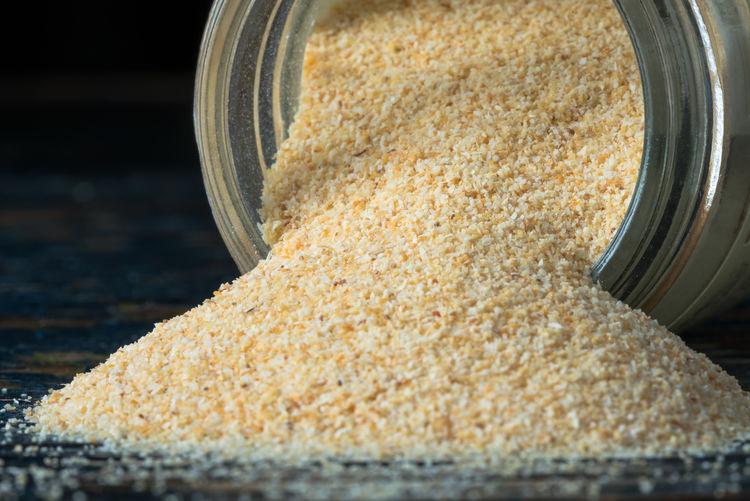 Garlic powder spilled from spice jar Cuisine Culinary Flavor Food Garlic Powder Ingredient Isolated Jar Seasoning Spice Spilled