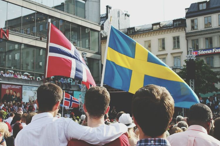 People with flags in city