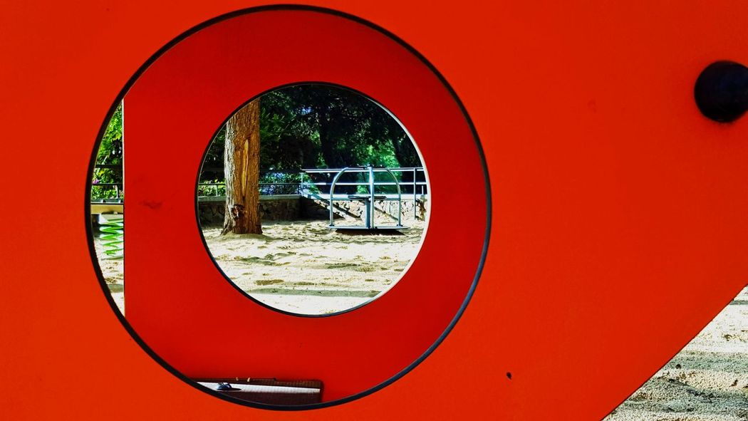 Close-up Orange Color Playground Equipment Playground City Life City Park Park - Man Made Space Streetphotography Low Angle View Play Playing Game Playing Games Playtime Red Circle Sports Target No People Day Outdoors Tree Concentric Astrology Sign