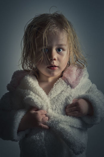 Close-up portrait of girl in bath robe
