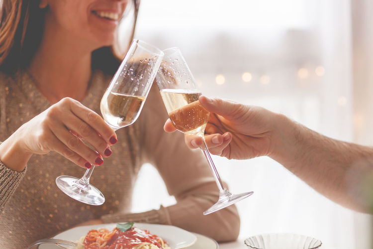 Food And Drink Glass Alcohol Human Hand Celebration Hand Holding Real People Refreshment Drink Women Lifestyles Adult Togetherness Friendship Leisure Activity Men Celebratory Toast Champagne Couple Horizontal Anniversary Lunch Love