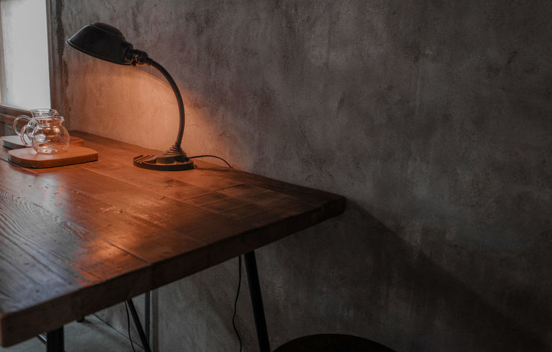 High angle view of empty chair on table against wall at home