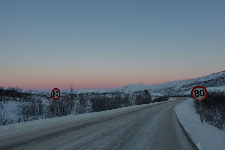 The road north from Finland to Norway Arctic Aurora Borealis Auroraborealis Cold Country Road Diminishing Perspective Dusk Empty Frozen Landscape Mountain Non-urban Scene Polar Night Remote Road Road Sign Scenics Snow Snow Covered The Way Forward Tranquil Scene Transportation Tromsø Vanishing Point Winter
