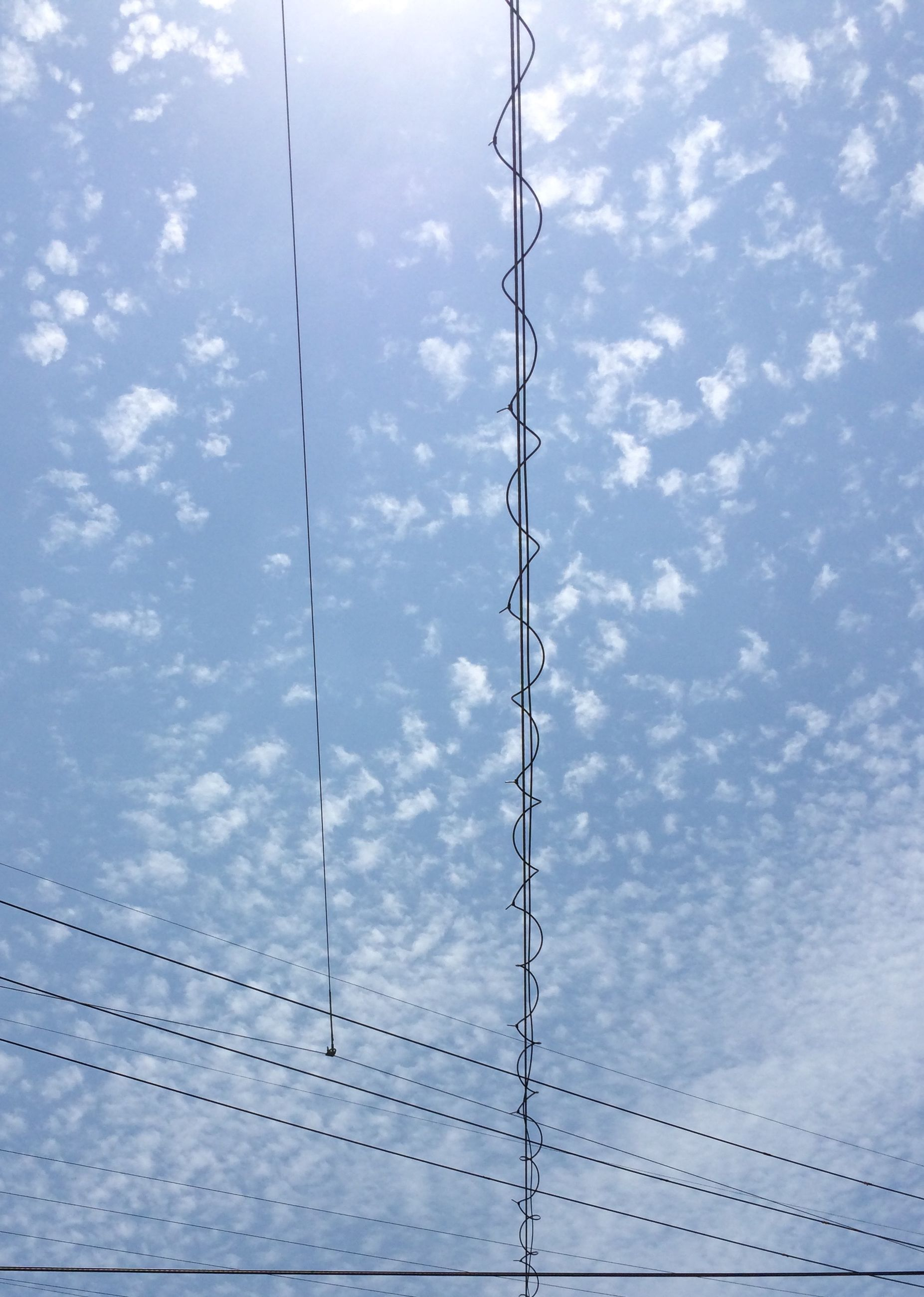 sky, low angle view, cloud - sky, cloudy, cloud, power line, day, cable, built structure, weather, electricity, street light, no people, outdoors, architecture, full frame, pattern, nature, backgrounds, connection