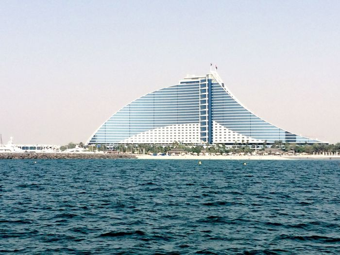 Architecture Architecture_collection Blue Building Built Structure Check This Out City Day Front View Hello World Jumeirah Beach Hotel Mid Distance Modern Modern No People Ocean Outdoors Sea Sky Skyscraper Tall Tall - High The Architect - 2016 EyeEm Awards Water Waterfront