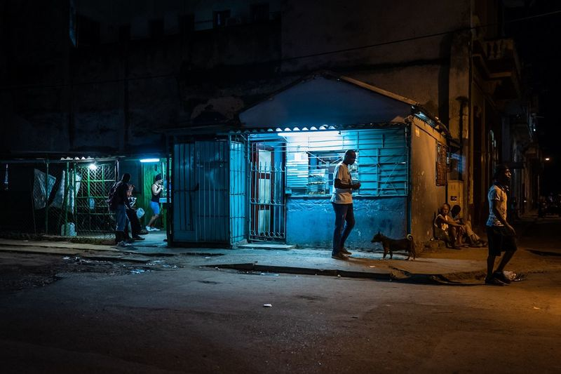 People working in abandoned building at night