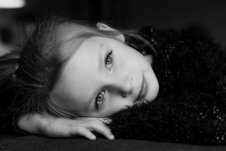portrait of a young girl, Head on her hands staring into the camera. black and white Child Girl B&W Portrait Blackandwhite Cute Lovely Portrait One Person Looking At Camera People Human Body Part Beautiful Woman Headshot Beauty Lying Down Human Eye Close-up Human Face Indoors  The Portraitist - 2018 EyeEm Awards The Fashion Photographer - 2018 EyeEm Awards