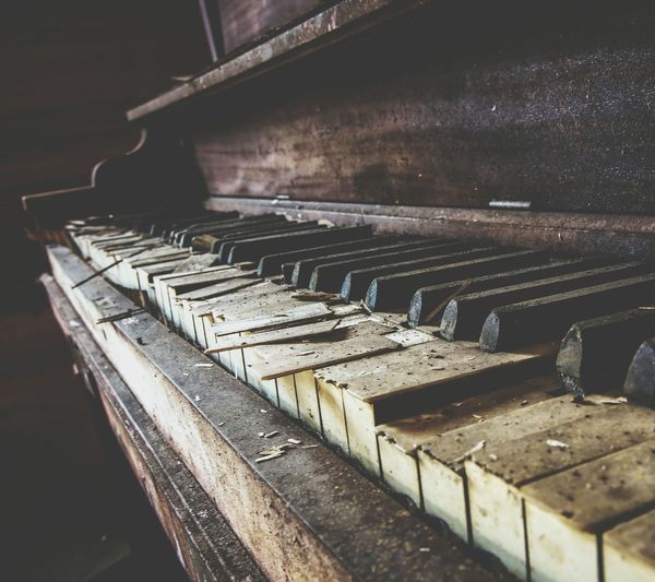 Close-up of abandoned piano