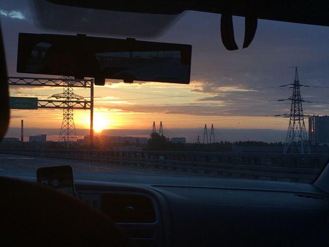 Sunrise Sky Mode Of Transportation Transportation Car Architecture Motor Vehicle Vehicle Interior City Windshield Travel Destinations Cloud - Sky