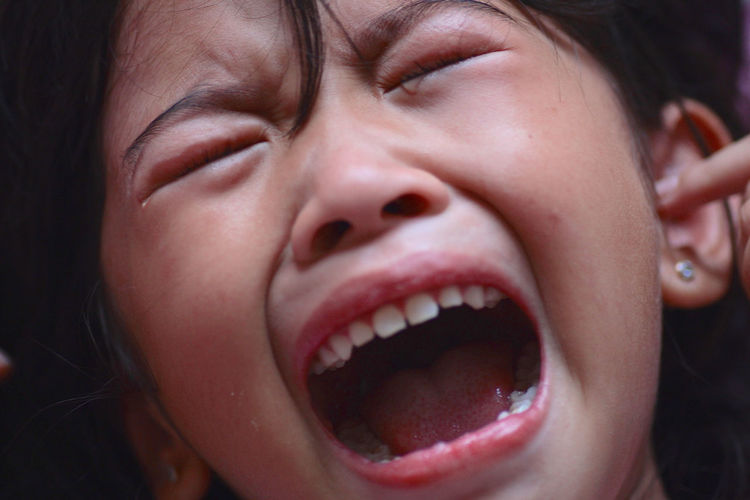 Close-Up Of Girl Crying