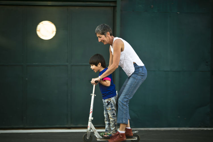 Mother With Son On Tricycle