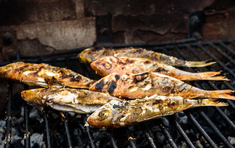 Directly Above Shot Of Fishes On Barbecue Grill