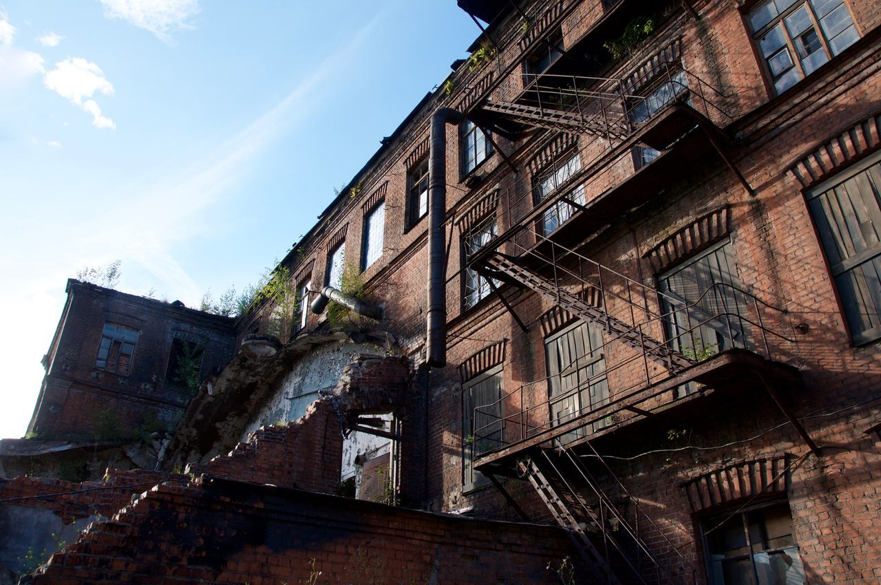 architecture, low angle view, building exterior, built structure, damaged, abandoned, sky, no people, window, bad condition, day, old ruin, outdoors, fire escape