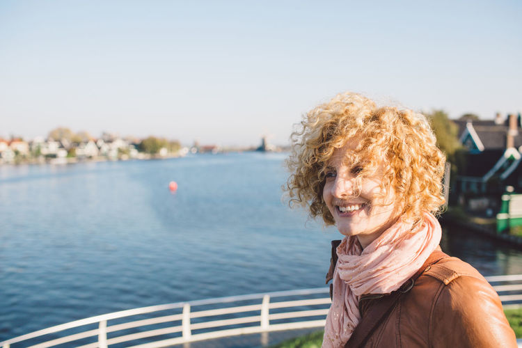 Smiling Woman Against River