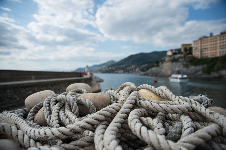 Camogli Cloud Cloud - Sky Cloudy Day Fishing Fishing Nets Focus On Foreground Harbor Italy Liguria Marine Naval Navaluenga No People Rope Ropes Sea Sky The Essence Of Summer Water