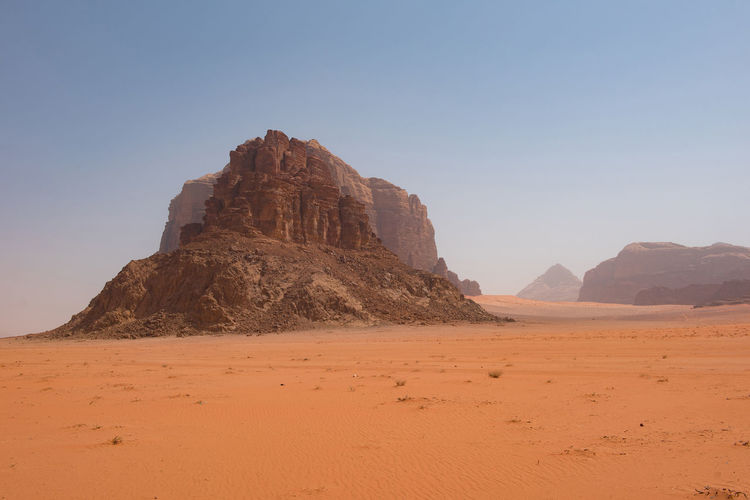 Rock formations on desert against sky