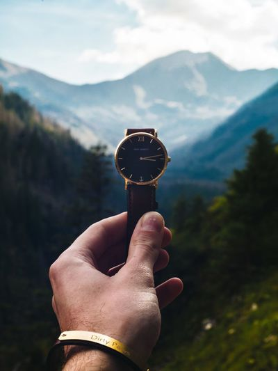 Human Hand Hand Human Body Part Holding Real People Mountain One Person Human Finger Lifestyles Personal Perspective Unrecognizable Person Body Part Finger Sky Leisure Activity Focus On Foreground Tree Nature Day Outdoors Watch Mountaintop Danielwellington Fashion Watch The Clock