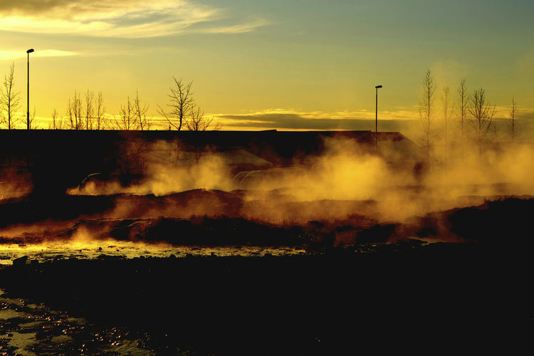 Beauty In Nature Burning Day Emitting Nature No People Outdoors Scenics Sky Smoke - Physical Structure Steam Steaming Earth Tree